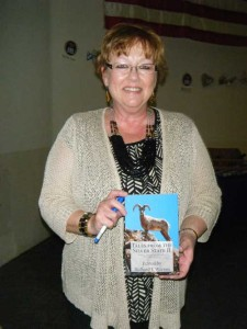 Photo of Barbra Wolfe holding Tales from the Silver State II